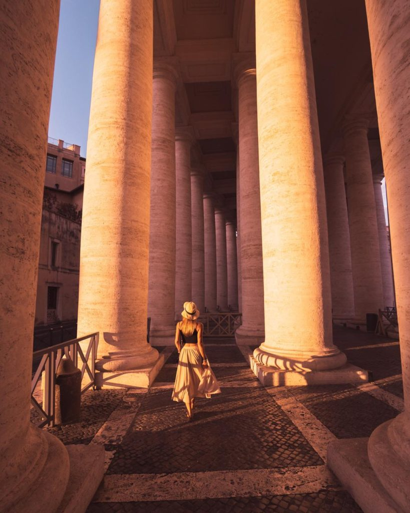 Girl walking inside the Vatican during sunrise