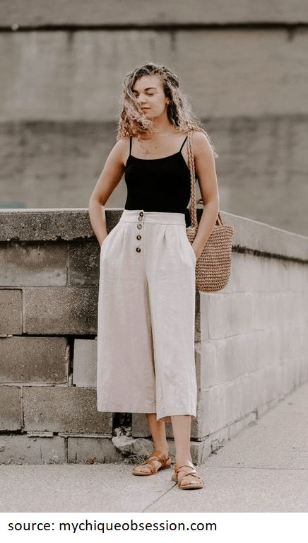 Below is a different combination. The beige linen pants paired with the black top look both fresh and stunning. The buttons on this high-wasted pants are just the cherry on top of the cake to make a beautiful, elegant style #linenpants #summeroutfits