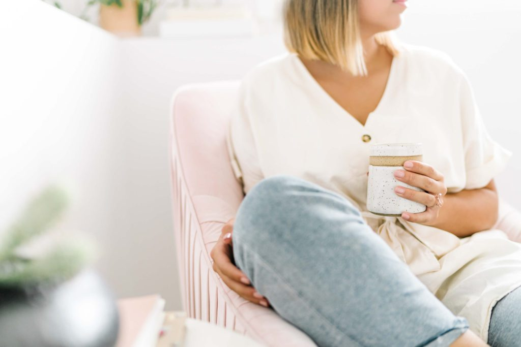 Girl wearing a white shirt drinking tea | Five Dimensions of Self-Care