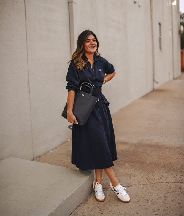 White Sneakers with Dress   Navy Blue Shirt Dress  with White Sneakers - My favorite summer style is the white sneakers with dress duo. The classic white sneaker style is timeless, casual and cute. Paired with a summer dress, white shoes are the ultimate fashion statement for summer and spring. #whitesneakers #whitesneakersoutfit ##whitesneakerswithdress #dress #summeroutfits #womensfashion  #sneakersstyle #whiteshoes
