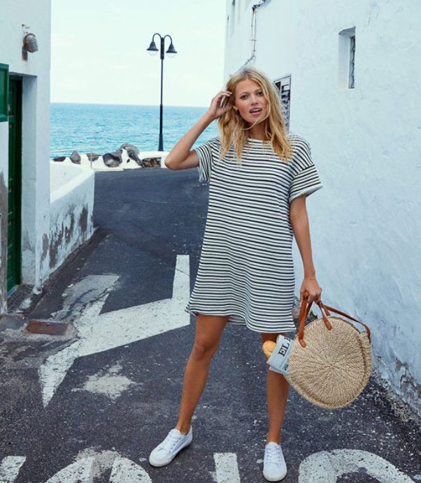 White Sneakers with Dress   Casual Short Striped Dress - My favorite summer style is the white sneakers with dress duo. The classic white sneaker style is timeless, casual and cute. Paired with a summer dress, white shoes are the ultimate fashion statement for summer and spring. #whitesneakers #whitesneakersoutfit ##whitesneakerswithdress #dress #summeroutfits #womensfashion  #sneakersstyle #whiteshoes