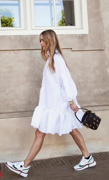 White Sneakers with Dress   White Oversized Puffy Sleeves Shirt - My favorite summer style is the white sneakers with dress duo. The classic white sneaker style is timeless, casual and cute. Paired with a summer dress, white shoes are the ultimate fashion statement for summer and spring. #whitesneakers #whitesneakersoutfit ##whitesneakerswithdress #dress #summeroutfits #womensfashion  #sneakersstyle #whiteshoes