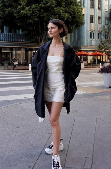 White Sneakers with Dress   Short White Dress and Oversized Shirt- My favorite summer style is the white sneakers with dress duo. The classic white sneaker style is timeless, casual and cute. Paired with a summer dress, white shoes are the ultimate fashion statement for summer and spring. #whitesneakers #whitesneakersoutfit ##whitesneakerswithdress #dress #summeroutfits #womensfashion  #sneakersstyle #whiteshoes