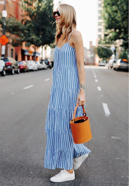 White Sneakers with Dress  Long Blue Stripped Dress, Orange Bag and White Sneakers Outfit- My favorite summer style is the white sneakers with dress duo. The classic white sneaker style is timeless, casual and cute. Paired with a summer dress, white shoes are the ultimate fashion statement for summer and spring. #whitesneakers #whitesneakersoutfit ##whitesneakerswithdress #dress #summeroutfits #womensfashion  #sneakersstyle #whiteshoes