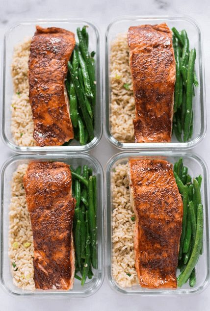 Meal prep of salmon, asparagus and brown rice in containers
