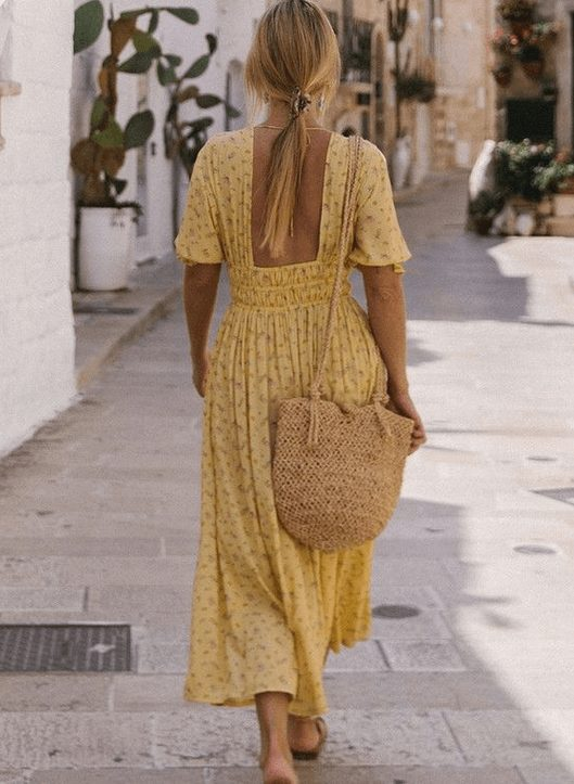 Fashion Tips for Women Over 30 from French Stylists such as this romantic yellow dress | Need some style advice and fashion tips from top French fashion designers? Understand what is the Parisian chic style, get style inspiration and style advice from French women style icons. This post has the best French style inspiration and French style guide for women over 30 for summer. #fashionadvice #fashiontips #styleadvice #frenchstyletips #parisianfashion #frenchwomanstyle #parisianchic