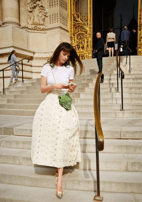 Fashion Tips for Women Over 30 from French Stylists such as this stunning midi skirt and white blouse | Need some style advice and fashion tips from top French fashion designers? Understand what is the Parisian chic style, get style inspiration and style advice from French women style icons. This post has the best French style inspiration and French style guide for women over 30 for summer. #fashionadvice #fashiontips #styleadvice #frenchstyletips #parisianfashion #frenchwomanstyle #parisianchic