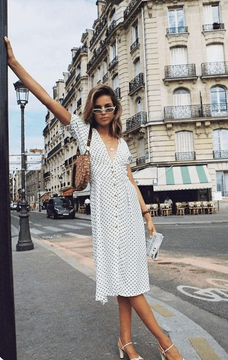 Fashion Tips How to Dress Like a French WomanOver 30 from French Stylists such as this white polka dot dress | Need some style advice and fashion tips from top French fashion designers? Understand what is the Parisian chic style, get style inspiration and style advice from French women style icons. This post has the best French style inspiration and French style guide for women over 30 for summer. #fashionadvice #fashiontips #styleadvice #frenchstyletips #parisianfashion #frenchwomanstyle #parisianchic