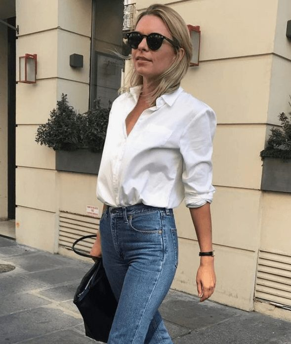 Fashion Tips for Women Over 30 from French Stylists such as this casual white blouse and denim jeans | Need some style advice and fashion tips from top French fashion designers? Understand what is the Parisian chic style, get style inspiration and style advice from French women style icons. This post has the best French style inspiration and French style guide for women over 30 for summer. #fashionadvice #fashiontips #styleadvice #frenchstyletips #parisianfashion #frenchwomanstyle #parisianchic