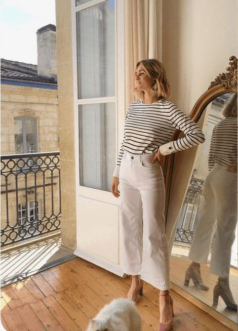 Fashion Tips for Women Over 30 from French Stylists such as this white pants and striped shirt | Need some style advice and fashion tips from top French fashion designers? Understand what is the Parisian chic style, get style inspiration and style advice from French women style icons. This post has the best French style inspiration and French style guide for women over 30 for summer. #fashionadvice #fashiontips #styleadvice #frenchstyletips #parisianfashion #frenchwomanstyle #parisianchic
