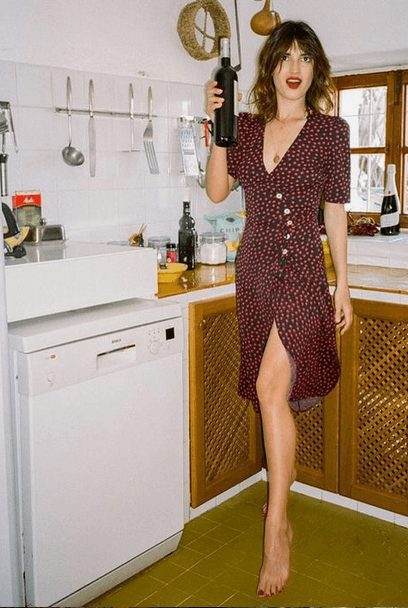 Fashion Tips for Women Over 30 from French Stylists such as this casual romantic red polka dot dress| Need some style advice and fashion tips from top French fashion designers? Understand what is the Parisian chic style, get style inspiration and style advice from French women style icons. This post has the best French style inspiration and French style guide for women over 30 for summer. #fashionadvice #fashiontips #styleadvice #frenchstyletips #parisianfashion #frenchwomanstyle #parisianchic