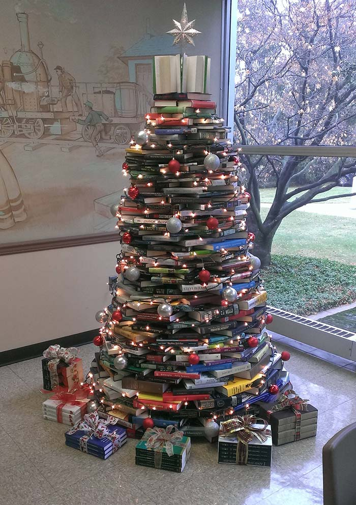 Christmas Tree Made from Your Favorite Books | Want ideas for unique Christmas trees for the 2020 holiday season? Find inspiration ideas for your Christmas tree decoration from creative and unique xmas trees. From white, upside down, best Christmas trees on wall, pink Christmas trees, and even Disney Christmas tree decorations. From big and small unique Christmas tree ideas. Perfect for kids and for the holidays. #uniquechristmastree #christmastreeideas #christmastreeideas #christmas