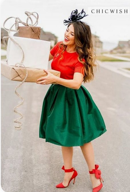 Girl wearing a Mix & Match, Green + Red Christmas Party Outfit holding xmas gifts