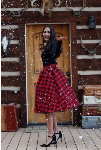 Girl wearing a Red Plaid Shirt with Long Sleeved Black Shirt out in the snow