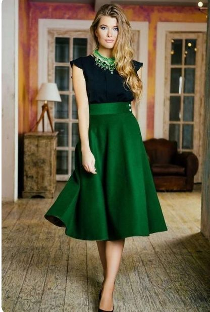 Girl wearing a Long Satin Green Skirt with Matching Green Necklace