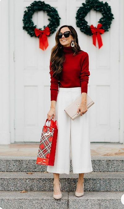 Girl wearing a  White Wide Leg Pants with Long Sleeved Red Shirt