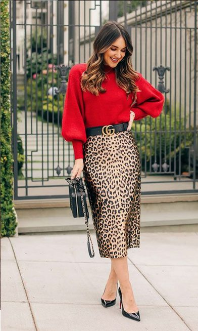 Girl wearing a  Long Sleeved Red Shirt with Leopard Pencil Skirt as a perfect classy Christmas party outfits idea