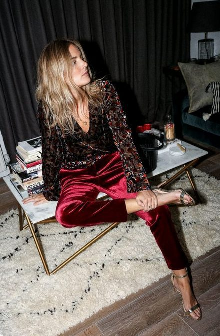 Red velvet pants are a super cute classy Christmas party outfits idea