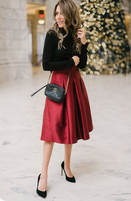 Girl wearing a Midi Red Satin Skirt with Long-Sleeved Black Shirt
