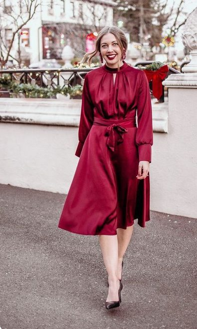 Girl wearing an All-Red, Long-Sleeved Chic Red Christmas Dress