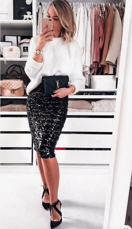 Girl wearing a Midi Black Sequins Skirt, White blouse and YSL handbag taking a mirror selfie