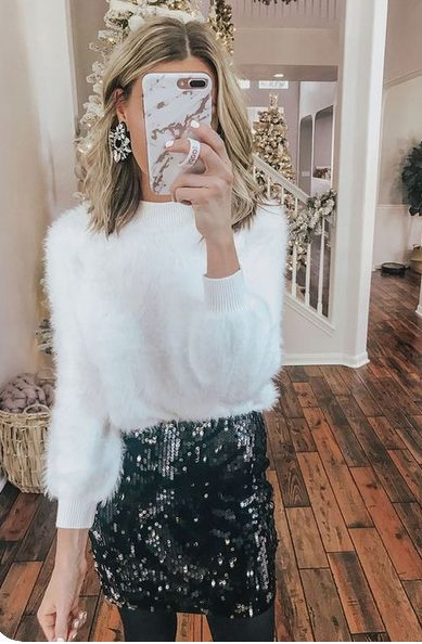 Girl wearing a White Faux fur shirt and blue Sequins skirt taking a selfie, the perfect Classy Christmas party outfits