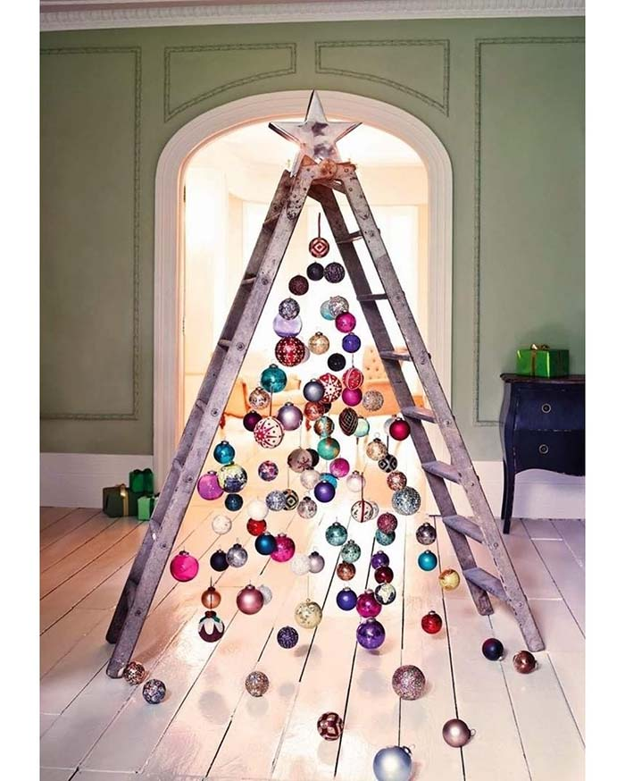 A Creative Christmas Tree Made from Stairs | Want ideas for unique Christmas trees for the 2020 holiday season? Find inspiration ideas for your Christmas tree decoration from creative and unique xmas trees. From white, upside down, best Christmas trees on wall, pink Christmas trees, and even Disney Christmas tree decorations. From big and small unique Christmas tree ideas. Perfect for kids and for the holidays. #uniquechristmastree #christmastreeideas #christmastreeideas #christmas