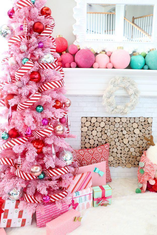 A Candy Cane Tree for Christmas | Want ideas for unique Christmas trees for the 2020 holiday season? Find inspiration ideas for your Christmas tree decoration from creative and unique xmas trees. From white, upside down, best Christmas trees on wall, pink Christmas trees, and even Disney Christmas tree decorations. From big and small unique Christmas tree ideas. Perfect for kids and for the holidays. #uniquechristmastree #christmastreeideas #christmastreeideas #christmas