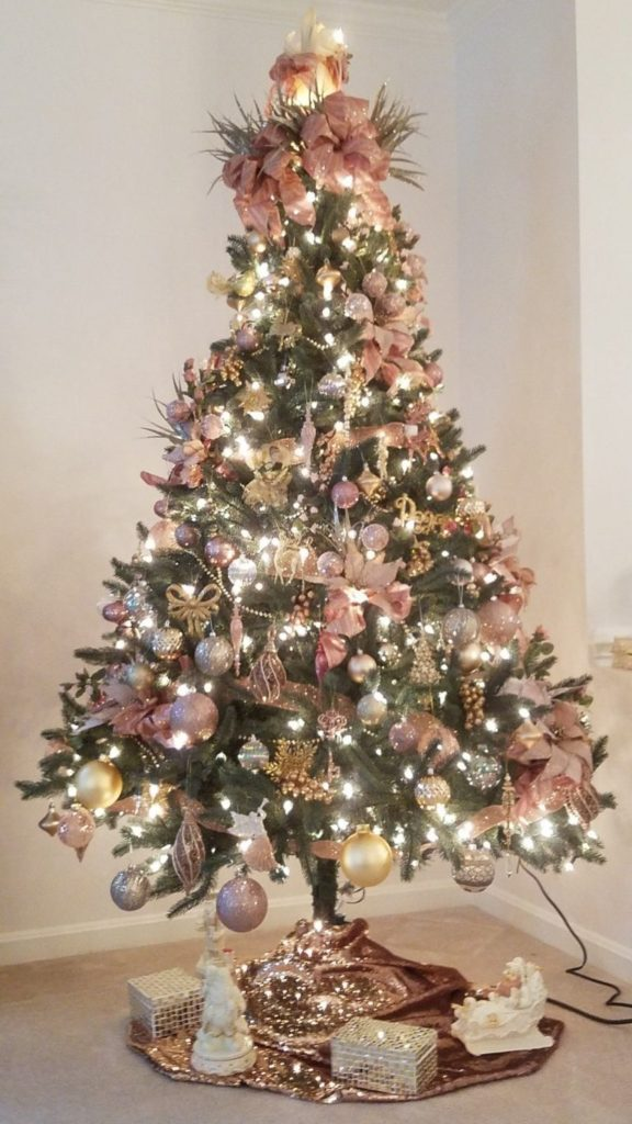An Elegant Pink Christmas Tree | Want ideas for unique Christmas trees for the 2020 holiday season? Find inspiration ideas for your Christmas tree decoration from creative and unique xmas trees. From white, upside down, best Christmas trees on wall, pink Christmas trees, and even Disney Christmas tree decorations. From big and small unique Christmas tree ideas. Perfect for kids and for the holidays. #uniquechristmastree #christmastreeideas #christmastreeideas #christmas