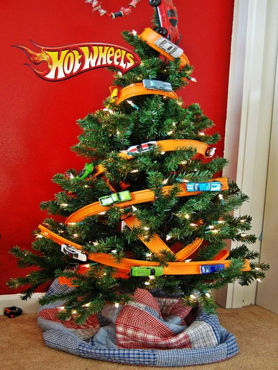 Hot Wheels Toy Christmas Tree Perfect for Boys | Want ideas for unique Christmas trees for the 2020 holiday season? Find inspiration ideas for your Christmas tree decoration from creative and unique xmas trees. From white, upside down, best Christmas trees on wall, pink Christmas trees, and even Disney Christmas tree decorations. From big and small unique Christmas tree ideas. Perfect for kids and for the holidays. #uniquechristmastree #christmastreeideas #christmastreeideas #christmas