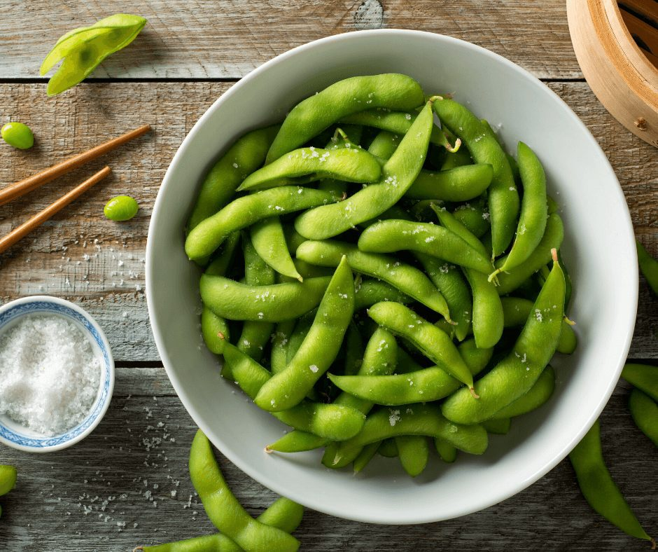 Delicious green edamame inside a white bowl is one of the most delicious and healthy snacks for movie night.