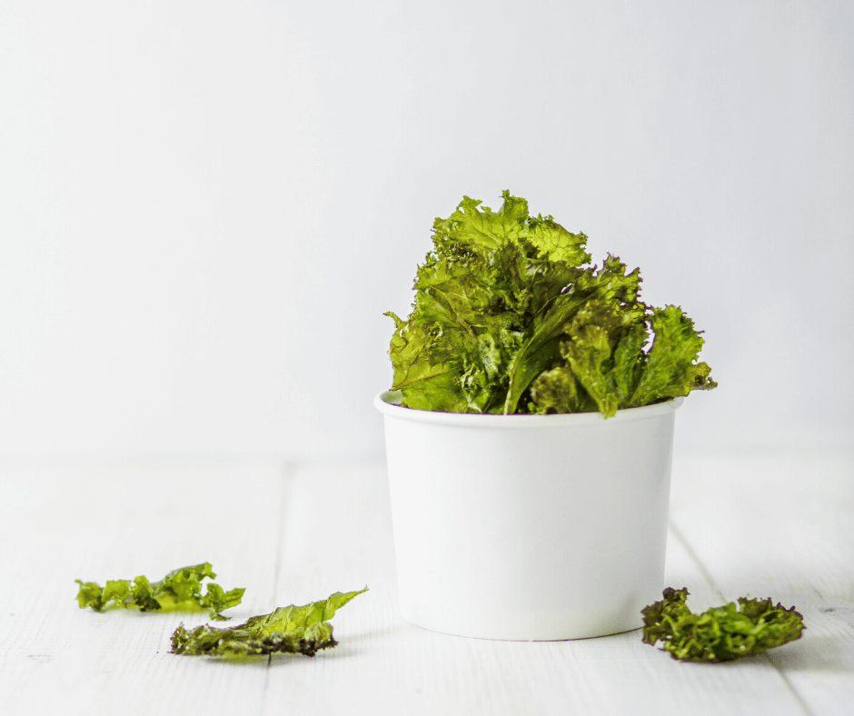 Crunchy Kale chips inside a white bowl