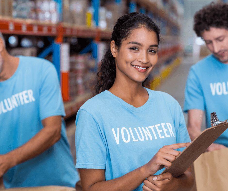 Girl wearing a blue Volunteer shirt