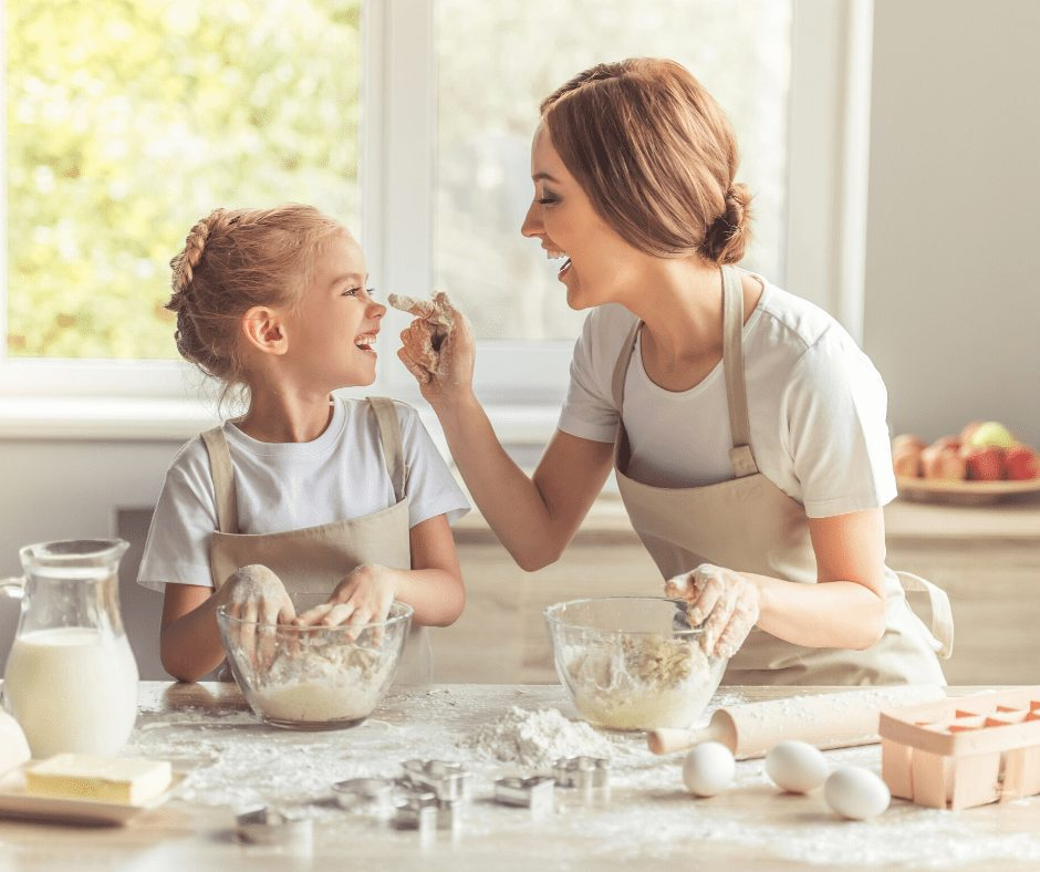 Mother and Daughter baking in the kitchen. Learning to bake is one of the great Hobbies for Women to Start