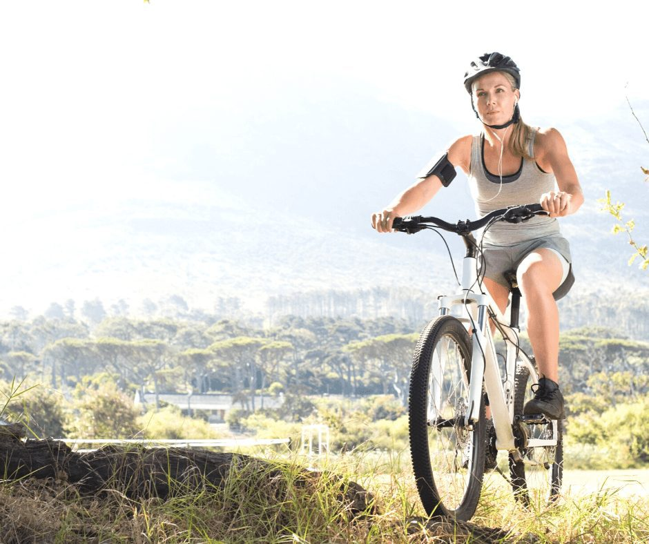 Girl on a mountain bike wearing a helmet. Cycling is one of the great Hobbies for Women to Start