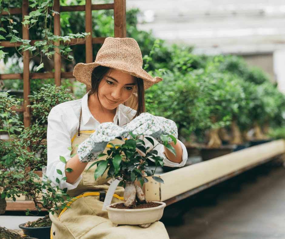 girl wearing gardening gloves and hat taking care of plants. Gardening is one of the great Hobbies for Women to Start