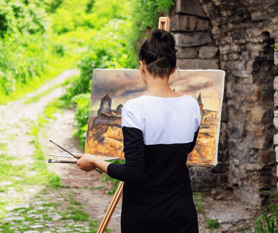girl backwards to the camera painting