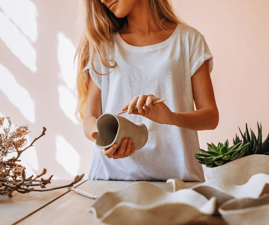girl learning ho to make pottery is one of the great hobbies for women to start in their 30s