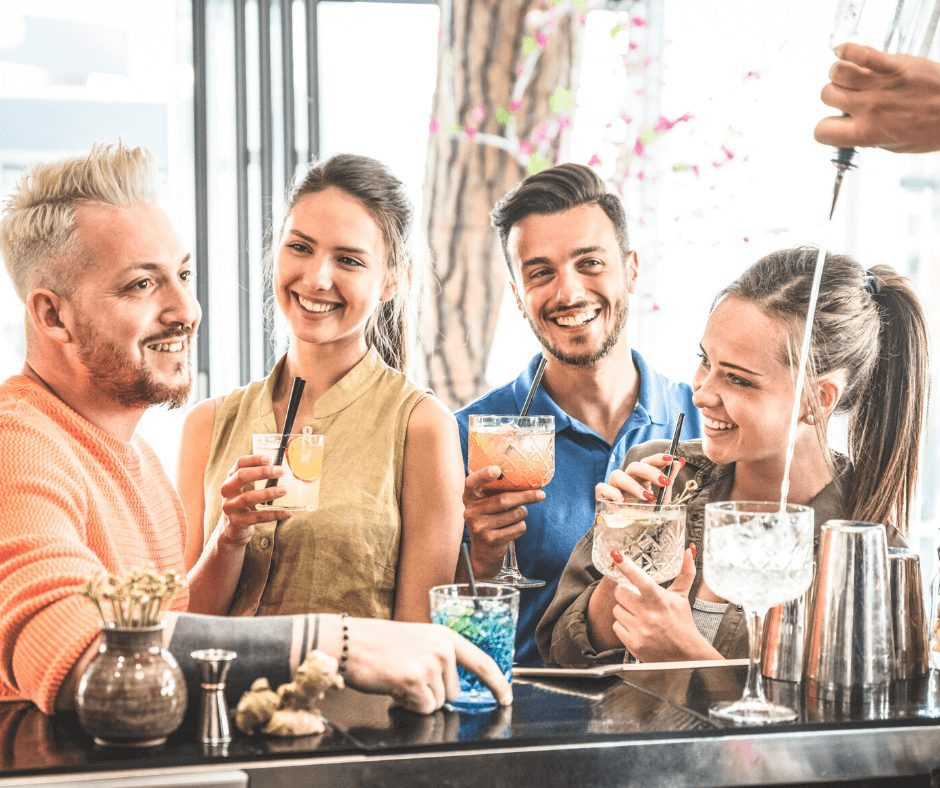 group of friends drinking at a bar