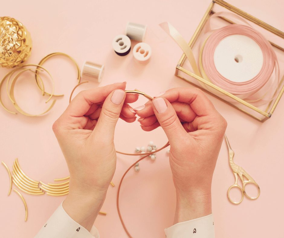 flat lay of hands making jewelry