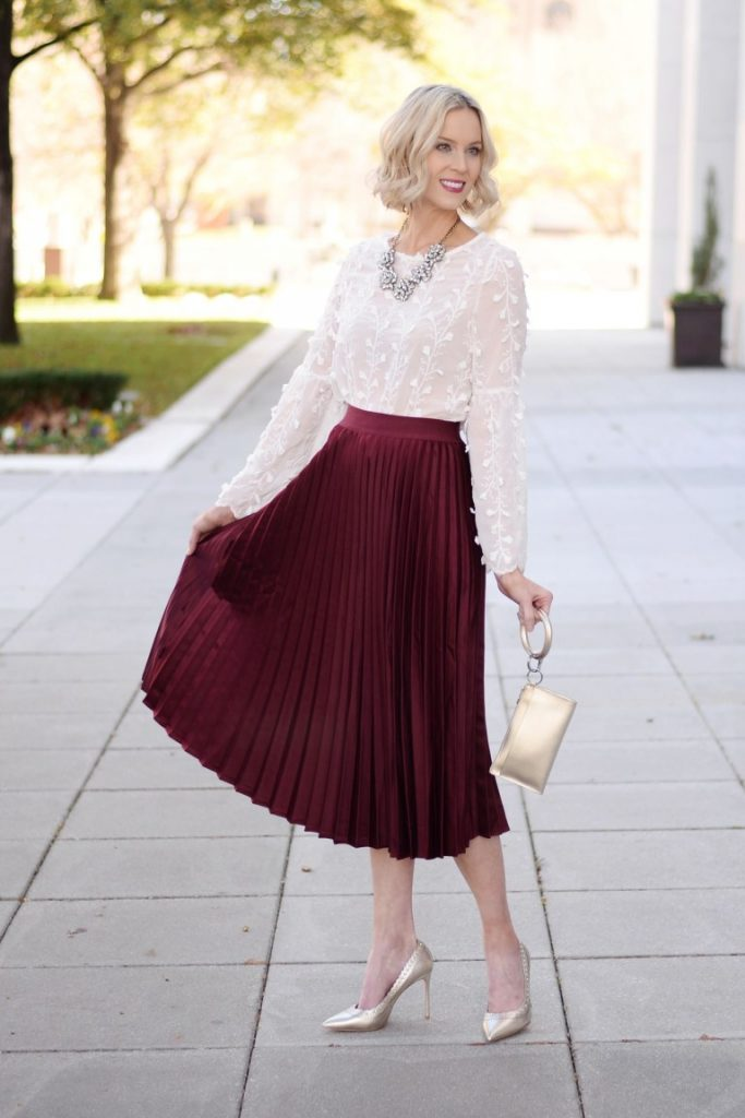 Girl wearing a Pleaded Maroon Midi Skirt with Transparent White Blouse