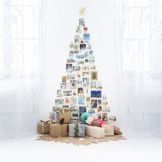 A Xmas Tree Made from Pictures | Want ideas for unique Christmas trees for the 2020 holiday season? Find inspiration ideas for your Christmas tree decoration from creative and unique xmas trees. From white, upside down, best Christmas trees on wall, pink Christmas trees, and even Disney Christmas tree decorations. From big and small unique Christmas tree ideas. Perfect for kids and for the holidays. #uniquechristmastree #christmastreeideas #christmastreeideas #christmas