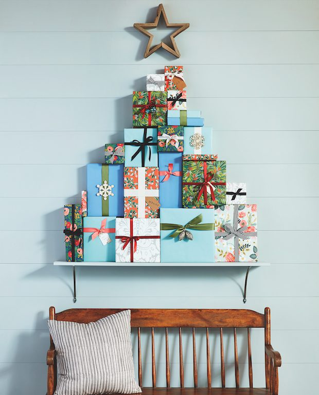 A Cute Christmas Tree Made From Presents | Want ideas for unique Christmas trees for the 2020 holiday season? Find inspiration ideas for your Christmas tree decoration from creative and unique xmas trees. From white, upside down, best Christmas trees on wall, pink Christmas trees, and even Disney Christmas tree decorations. From big and small unique Christmas tree ideas. Perfect for kids and for the holidays. #uniquechristmastree #christmastreeideas #christmastreeideas #christmas