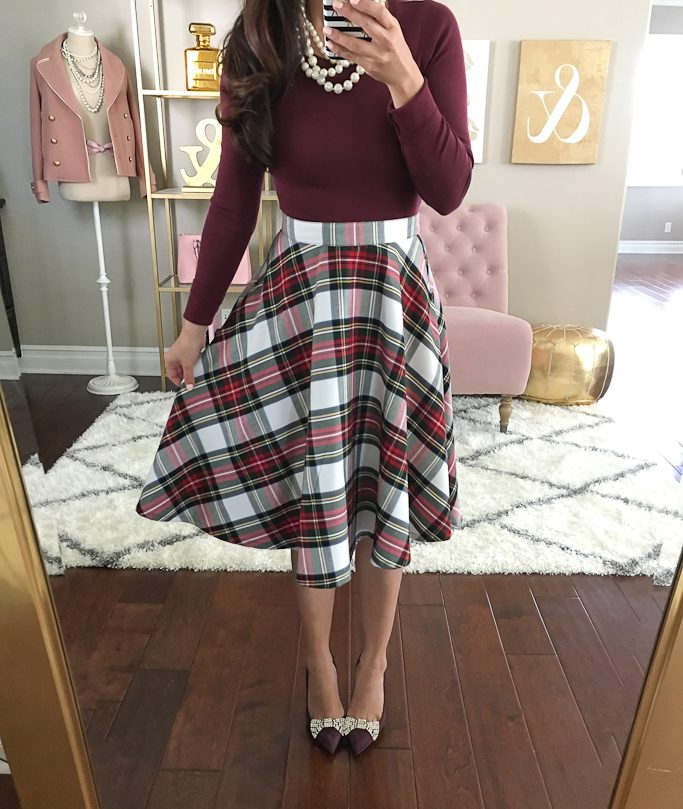 Girl wearing a Maroon Plaid Skirt with Matching Maroon Long-Sleeved Shirt