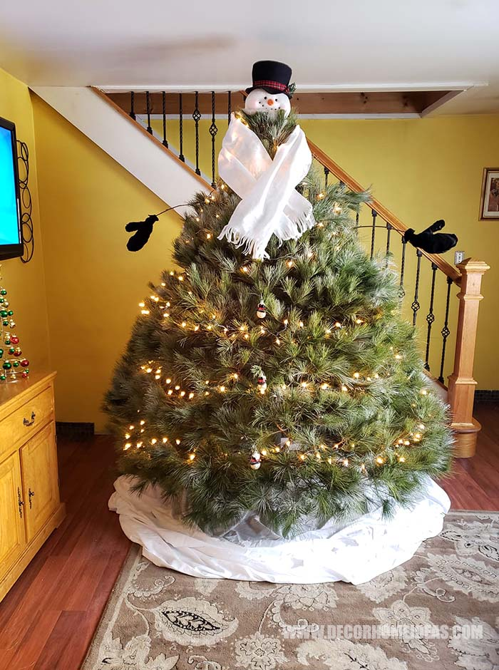 Adorable Snowman Hug Christmas Tree | Want ideas for unique Christmas trees for the 2020 holiday season? Find inspiration ideas for your Christmas tree decoration from creative and unique xmas trees. From white, upside down, best Christmas trees on wall, pink Christmas trees, and even Disney Christmas tree decorations. From big and small unique Christmas tree ideas. Perfect for kids and for the holidays. #uniquechristmastree #christmastreeideas #christmastreeideas #christmas