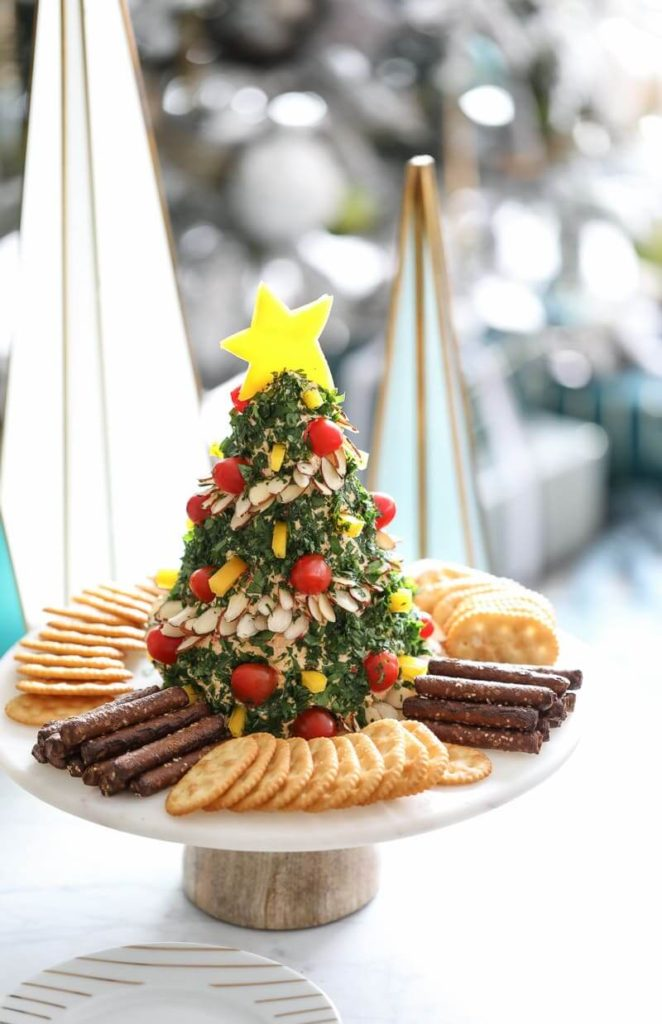 Christmas Tree Cheese Ball | Want to serve your guests the best Christmas party appetizers this year? Find a list of 40+ Christmas appetizers ideas & easy recipes for Christmas party appetizers, both sweet and savory holiday food. From elegant Christmas finger food ideas to easy dips, and simple crockpot holiday appetizers, (vegetarian, keto and even gluten-free appetizer ideas), perfect for a crowd and for kids. #christmaspartyappetizers #appetizersforchristmasparty #christmasparty #fingerfood #christmasfood