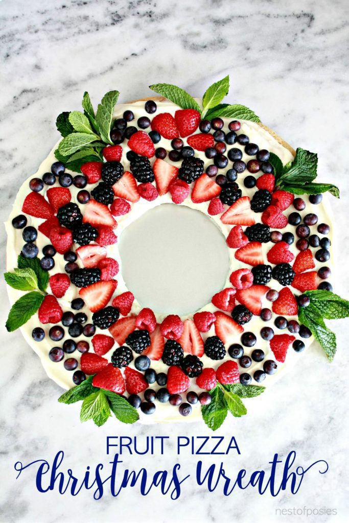 Fruit Pizza Wreath | Want to serve your guests the best Christmas party appetizers this year? Find a list of 40+ Christmas appetizers ideas & easy recipes for Christmas party appetizers, both sweet and savory holiday food. From elegant Christmas finger food ideas to easy dips, and simple crockpot holiday appetizers, (vegetarian, keto and even gluten-free appetizer ideas), perfect for a crowd and for kids. #christmaspartyappetizers #appetizersforchristmasparty #christmasparty #fingerfood #christmasfood