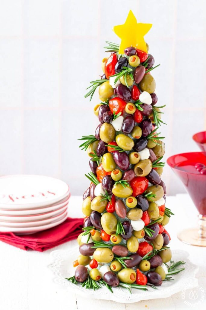 Olive Christmas Tree Appetizer | Want to serve your guests the best Christmas party appetizers this year? Find a list of 40+ Christmas appetizers ideas & easy recipes for Christmas party appetizers, both sweet and savory holiday food. From elegant Christmas finger food ideas to easy dips, and simple crockpot holiday appetizers, (vegetarian, keto and even gluten-free appetizer ideas), perfect for a crowd and for kids. #christmaspartyappetizers #appetizersforchristmasparty #christmasparty #fingerfood #christmasfood