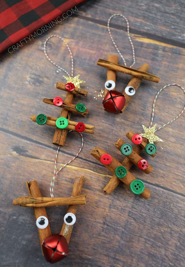 Cinnamon Stick Reindeer & Tree Ornaments resting on a wooden table