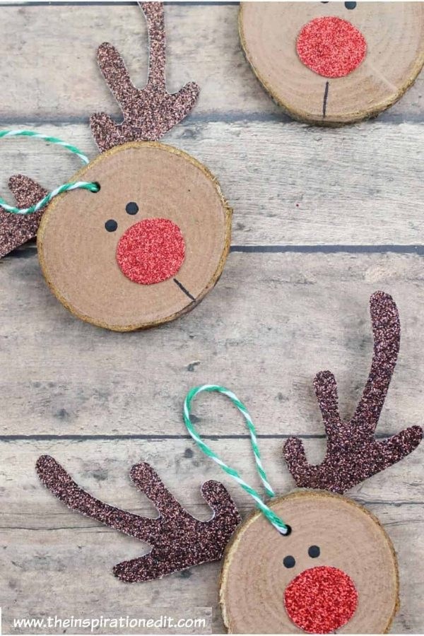 Rudolf Christmas DIY Craft For Kids flat lay on a wooden surface